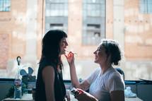 a makeup artist putting on makeup