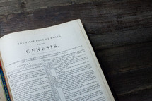 A Bible open to the book of Genesis.