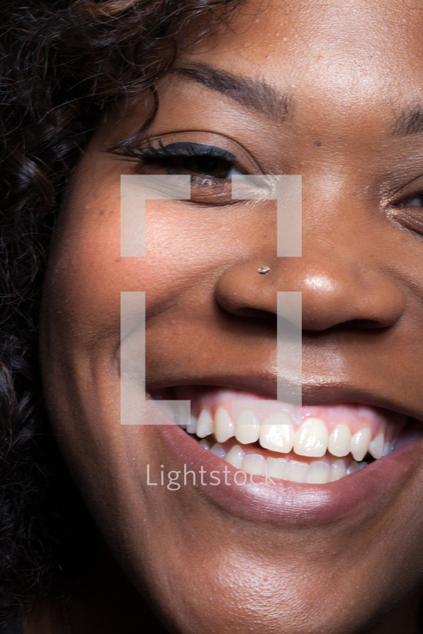 closeup of the face of a smiling woman