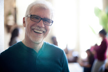 smiling man at a small group gathering