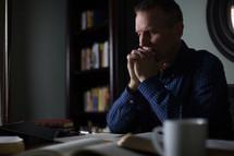A pastor in prayer