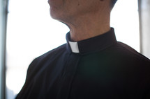 A minister wearing a clerical collar.