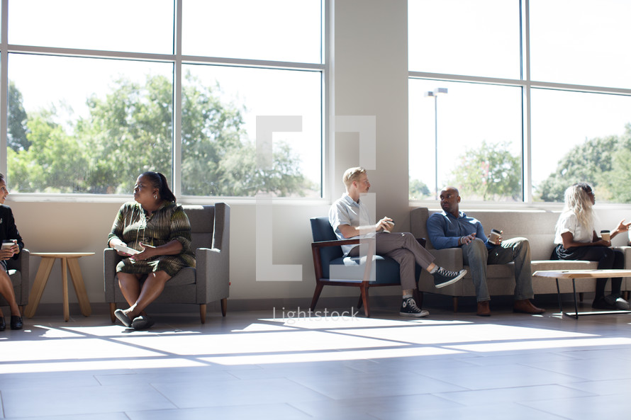 conversations in the lobby of the Harvest Church building