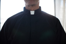 A minister in a clerical collar.