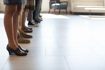 legs of people standing in a row in the Harvest Church building