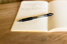 a pen on a journal