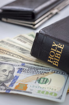 wallet, Bible, and cash