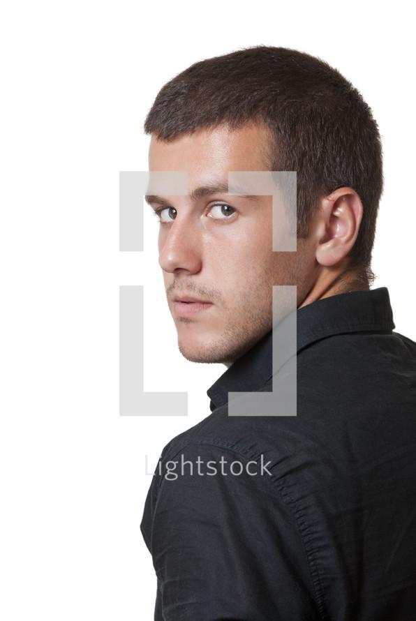 Man looking over his shoulder.