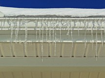 Icicles hanging off a gutter.