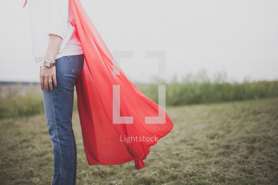 A super hero mom dressed in a red cape
