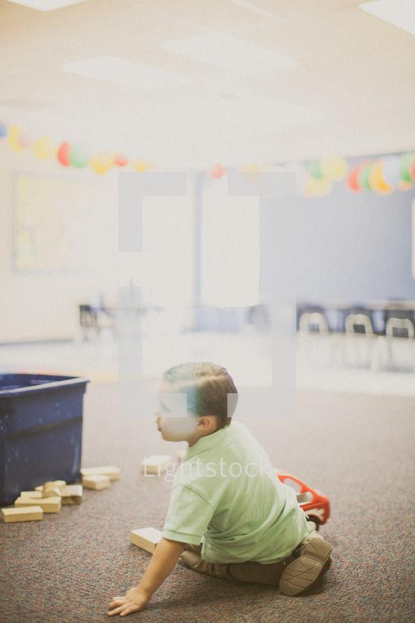 boy child playing with blocks