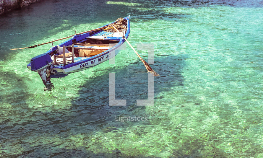 row boat on turquoise water