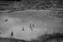 children playing on a shore in Luwuk