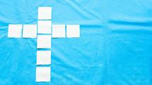 cross sticky pads on a blue background