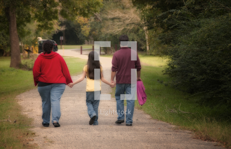 family walking holding hands