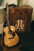 vintage radio and acoustic guitar