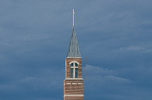 church bell tower and steeple against stormy sky