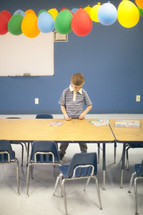 balloons in a classroom and boy child