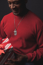 man opening a Christmas gift