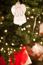 An angel ornament hanging on a Christmas ornament