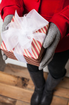 pped, Christmas, gift, present, gloves, red coat, woman, holding