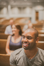 parishioners sitting in the pews of a church