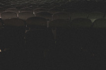 Rows of theater chairs.