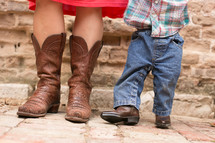 A Mom and Son wearing cowboy boots