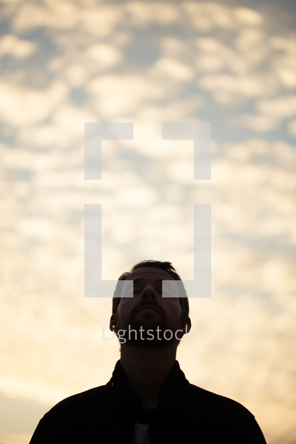 man with his head raised in praise to God