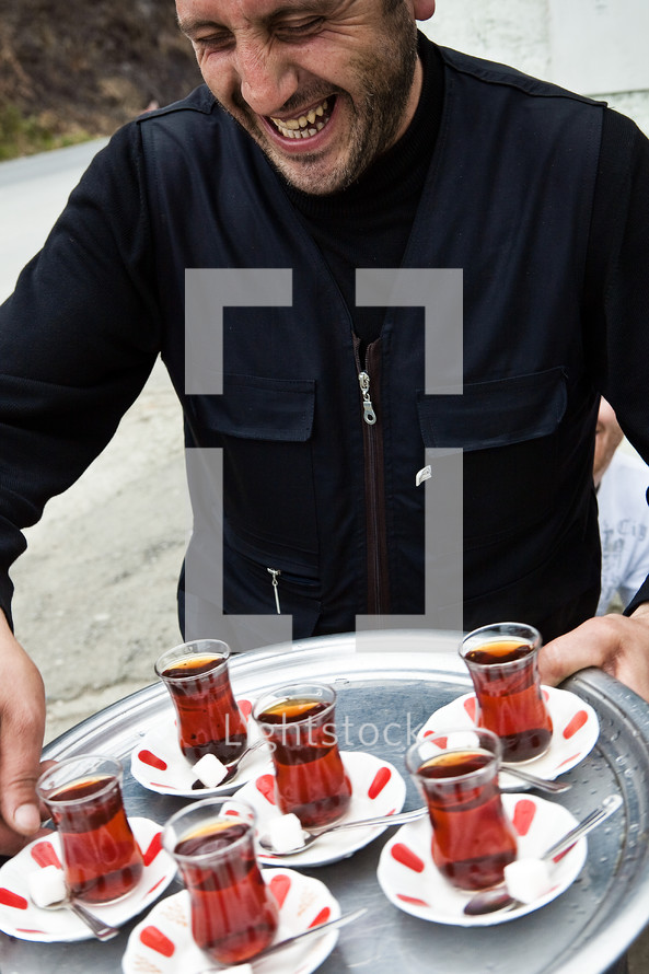 Turkish man offering tea