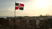 Dominican Republic flag over city