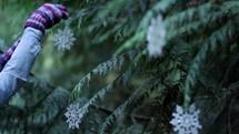 woman, decorating, Christmas tree, gloves, snowflake ornament, tree, Christmas