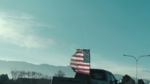 American flag in the back of a pickup truck