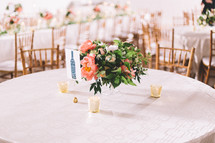 flower arrangement on the center of a table at a wedding reception