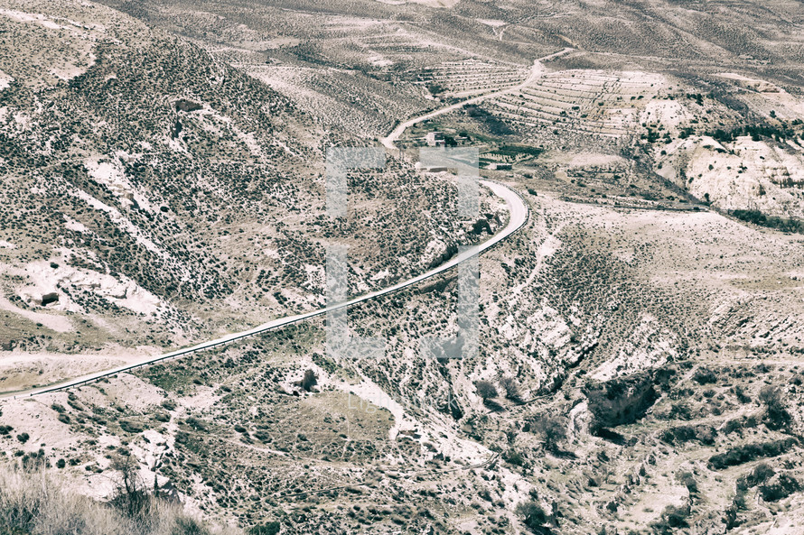 winding road through a desert view from castle ruins