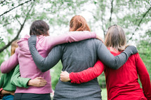 women with arms around each other