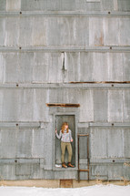 a woman standing in front of a building