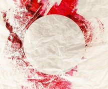 circle and red paint on a drop cloth