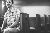 man sitting in a church pew