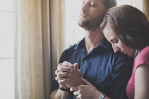 husband and wife praying together