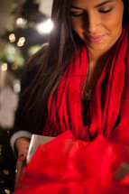 An african-American woman holding a Christmas gift