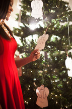 paper angel, angel, woman, African-American, woman, holding, Christmas, red dress