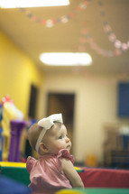 infant girl in a church nursery