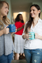 women in conversation drinking coffee at a women's group Bible study