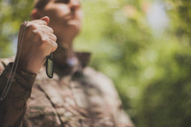 serviceman holding his dog tags