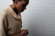 African-American woman in prayer