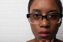 face of an African-American woman with reading glasses