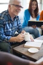 reading Bibles at an adult Bible study
