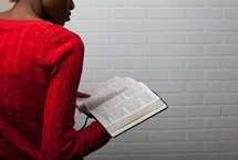 African-American woman reading a Bible