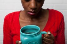 African-American woman holding a mug